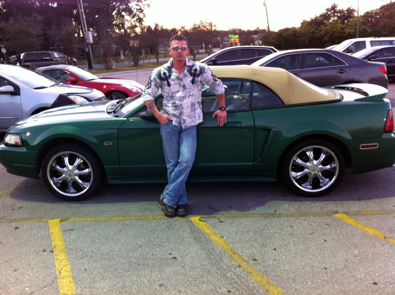 Ronnie Rokk Smith by his Mustang GT
